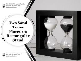 Two Sand Timer Placed On Rectangular Stand