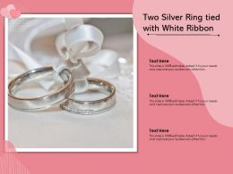 Two Silver Ring Tied With White Ribbon