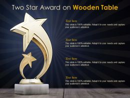 Two Star Award On Wooden Table