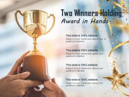 Two Winners Holding Award In Hands