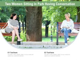Two Women Sitting In Park Having Conversation