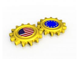 Union Of Us And European Flags Inside Gears Stock Photo