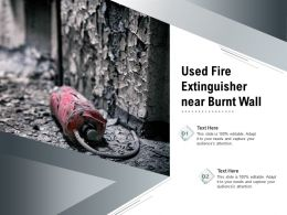Used Fire Extinguisher Near Burnt Wall
