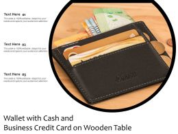 Wallet With Cash And Business Credit Card On Wooden Table