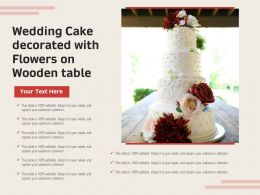 Wedding Cake Decorated With Flowers On Wooden Table