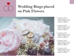 Wedding Rings Placed On Pink Flowers