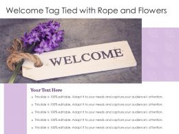 Welcome Tag Tied With Rope And Flowers