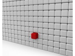 White Cubes Wall With One Red Block As Leader Stock Photo