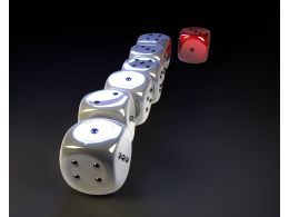 White Dices In Row With One Red Dice Displaying Leadership Stock Photo