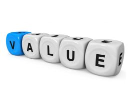 White Dices With One Blue Carrying Value Text And Leadership Stock Photo