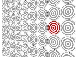 White Target Background With One Red Dart As Leader Stock Photo