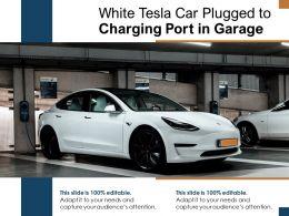 White Tesla Car Plugged To Charging Port In Garage