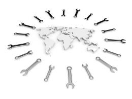 White World Map Surrounded With Multiple Wrenches Stock Photo