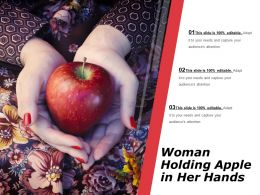 Woman Holding Apple In Her Hands