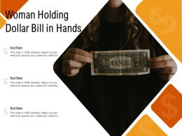 Woman Holding Dollar Bill In Hands