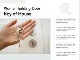 Woman Holding Door Key Of House