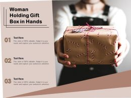Woman Holding Gift Box In Hands