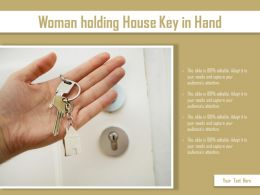 Woman Holding House Key In Hand