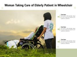 Woman Taking Care Of Elderly Patient In Wheelchair