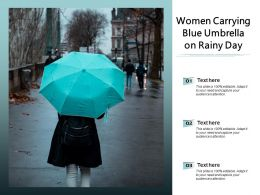 Women Carrying Blue Umbrella On Rainy Day