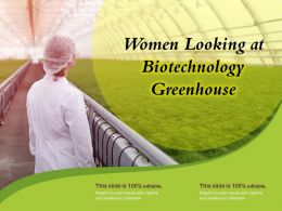 Women Looking At Biotechnology Greenhouse