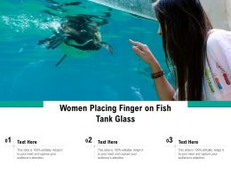Women Placing Finger On Fish Tank Glass