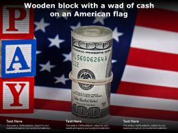 Wooden Block With A Wad Of Cash On An American Flag