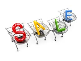 Word Sale In Shopping Carts On White Background Stock Photo