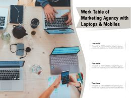 Work Table Of Marketing Agency With Laptops and Mobiles