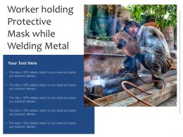 Worker Holding Protective Mask While Welding Metal