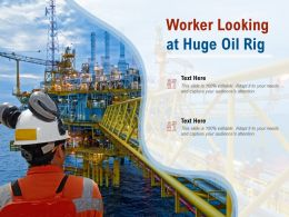 Worker Looking At Huge Oil Rig