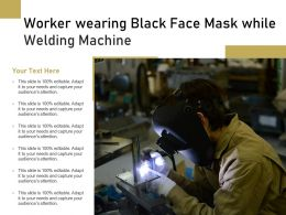 Worker Wearing Black Face Mask While Welding Machine