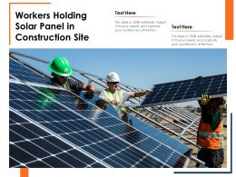 Workers Holding Solar Panel In Construction Site