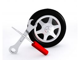 Wrench And Screwdriver With Tire Showing Service Stock Photo