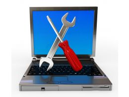 Wrench With Screwdriver And Laptop For Service Repair Stock Photo
