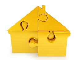 Yellow Colored Puzzle With Hut Shape Stock Photo