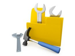 Yellow Folder With Two Wrenches Inside One Hammer Outside Stock Photo