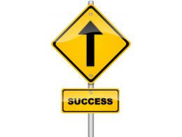 Yellow Signpost For Success Stock Photo