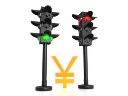 Yen Symbol In Between Traffic Lights Stock Photo