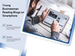 Young Businessman Reading Blogs On Smartphone