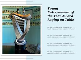 Young Entrepreneur Of The Year Award Laying On Table