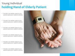 Young Individual Holding Hand Of Elderly Patient