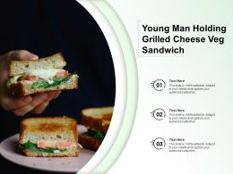 Young Man Holding Grilled Cheese Veg Sandwich