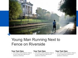 Young Man Running Next To Fence On Riverside