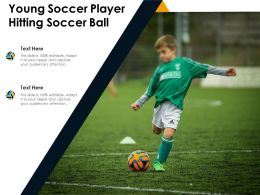 Young Soccer Player Hitting Soccer Ball
