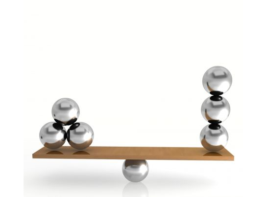 0914 silver balls on balancing scale stock photo