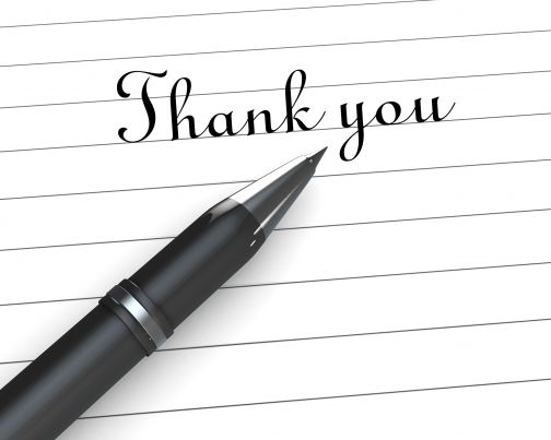 0914 Thank You Note On Paper With Pen Stock Photo