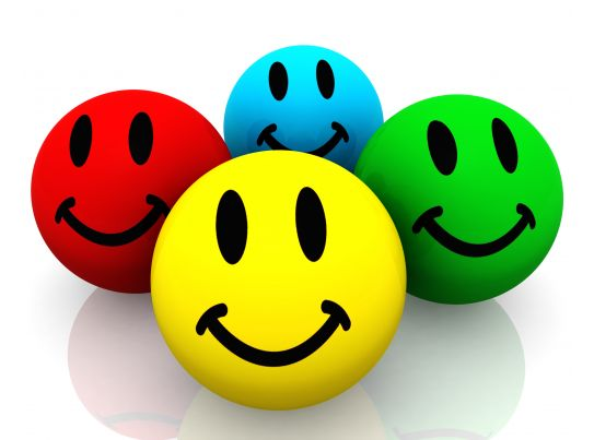 Smiley Face Backgrounds: Colorful Smileys On White Background Stock Photo