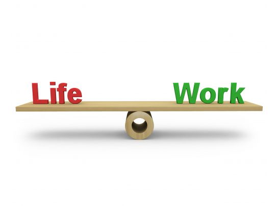 life and work text on balance scale stock photo