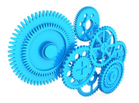 many gears working together stock photo